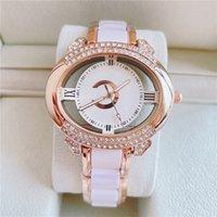 Moda Marca Relojes Mujer Muchacha Hueco Out Crystal Oval Estilo Banda de acero Reloj de pulsera CH57