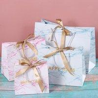 Envoltura de regalo 1 unid cinta de oro arco-nudo bolsas bolsas de boda Packaging Jewelry Caja de joyería Mármol impreso Papel Bolsa de asas DIY Cajas de aniversario