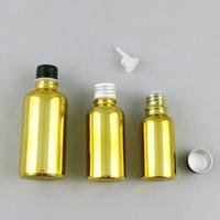 Frascos de almacenamiento Frascos 12 x 5 ml 10ml 20ml 30ml 50ml 100ml Botella de cristal de oro recargable con tapa de aluminio Inserción PE 1 oz Cosmetic Contaienrs
