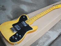Electric guitar with dual LP pickups retro yellow body and neck with large black guard board