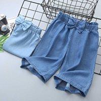 النسخة الكورية من Tianshi Xia الخفيفة الفتيات القوس التعادل الجينز الساق واسعة عارضة تنورة مستقيم capri السراويل