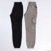 Konng gonng primavera e verão homens calças moda marca retrô multi bolso macacões jogging leggings amarrar os pés