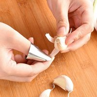 أدوات المطبخ الصنوبر المنزلية أدوات المطبخ الصنوبرة الفولاذ المقاوم للصدأ اليد الحرس البقان كليب كستنائي مقشرة 4 * 2.5 سنتيمتر xd24591