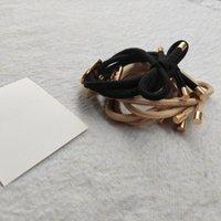 Nouveaux cravates à cheveux élastiques avec des accessoires de corde de cheveux métalliques en métal avec une carte de papier