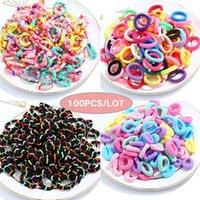 Accesorios para el cabello Wyinya 100 Piezas / Paquete De Alto Color Elástico Color Pequeño Corbata Negra Cuerda Negro Joyería Para Niños Anillo de Toalla Seamles