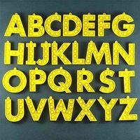 アルファベットの呪文の単語プッシュバブル26文字フィジゲットポップのおもちゃバッグペンダントキーホルダー子供科学と教育シリコーン感覚のおもちゃG67OHWQ