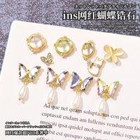 Décorations d'art des ongles 100 pièces cristal 3D cristal strass strass papillon / goutte artisanat pierres précieuses avec pierres de pierres précieuses (brillant 17 styles)