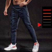 Беговые брюки Bintuoshi Дышащие эластичные спортивные брюки Мужские застежки на молнии Обучение брюки Joggings Фитнес брюки для мужчин