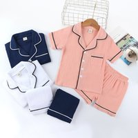 Kid Pyjamas Sleepwear Vêtements Ensemble Garçon Girl Manches courtes avec Shorts de poche 2 Pièces Verties Été Homewear Nightwear Nightwear