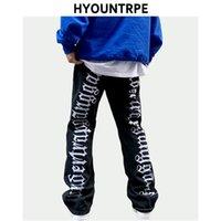 Moda de volta Letras Bordado Bordado Denim Flare Jeans Mens Zipper Calças Hipas Hip Hop Destruir Buracos Calças Calças Bocais 210714