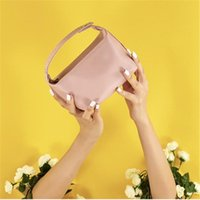 Sacs cosmétiques Casques Sac Femme Grande capacité Cuir PU Haute Qualité Classique Couleur Pure Couleur Portable Lave-linge Recevoir Voyager