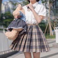 Faldas Falda de las mujeres jóvenes Harajuku Classic Blue Blue Plised Tops Set Set High Waist Office Lady Mini Blanco Camisa