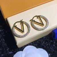 Diseño de letras Gran círculo Pendientes simples de la nueva moda para mujer aro de aro para mujer de alta calidad 2 color con caja