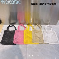 Дизайнеры соломенные сумки ручной работы сумки сплошной цвет хлопчатобумажные веревки женщины одно плечо полые сетки сумки каникула путешествия тканая сумка PP21071702