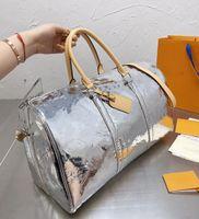 2020 جديد وصول مصمم duffel أكياس الرجال جودة عالية الجلود حقيبة سفر الأمتعة عطلة نهاية الأسبوع حقيبة يوم مخلب رياضة حقيبة محفظة