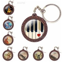 Keychains Music Instrument Picture Keychain Piano Guitar Clarinet Flute Violin Sax Glass Cabochon Wooden Fashion Accessories