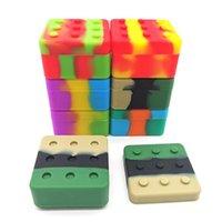 Nuovo 4 + 1 contenitore del silicone contenitore del contenitore quadrato della scatola quadrata antiaderente della scatola di blocco 26ml per il barattolo della conservazione del silicone dell'erba asciutta dell'olio della cera del DAB
