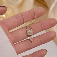 Cadenas Brillantes Bling Zircon Lock Key Collares para mujeres Clavícula Cadena Charm Boda Colgante 14K Joyería de oro real