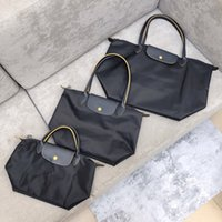 Bolsos para mujer Monederos Compras Bolsos de playa grandes Bolsos Pochette Nylon Handbag Oxford Real Cuero Top Top Calidad Bolso de la mano de viaje