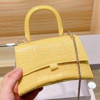 Bolsas de cadena de mujeres de alta calidad de diseño de lujo Diseñador de cuero Rojas de arena Bolsa de jalea Exquisito 5 Color Versátil Cross Body Handbag