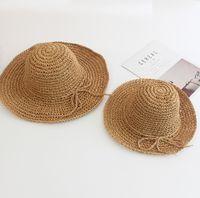 الأطفال القش العشب أشعة الشمس القبعات الاطفال طوي الانحناء حزام واسعة بريم بنما قبعة الفتيات الشاطئ السفر سونحات قناع الأم وأنا مطابقة قبعة Q0347