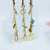 High Qualtiy Marque Designer Alliage Keychain Fashion 3 couleurs Pendentif Car chaîne de voiture Charme Brown Flower Mini sac KeyRingThinket Cadeaux Accessoires