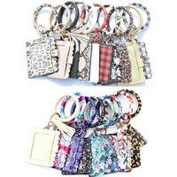 Modern Parti Par Små present PU Läder Tassel Armband ID Kortväska Klassisk Tecknad Mönster Nyckelring