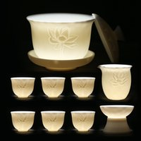 Juego de té de lanolin jade de cerámica de la sutura Lotus Kung Fu Cup Matte White Sanci Cover Set de regalo