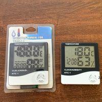 Termómetro de higrómetro de higrómetro de temperatura LCD digital Termómetro con calendario de reloj HWB9010