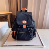 2021 Brand Designer Rucksack Männer und Frauen Top Qualität Mode Luxus Leinwand Kalbsleder Reisetasche Rucksack Größe 25 * 13 * 32 cm