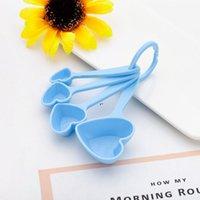 Cuchara en forma de corazón Cucharas de medición de la boda del regalo de la boda del regalo de la fiesta de bienvenida al bebé Favor de la cucharada de la cocina para hornear cucharas de plástico Regalos DWE8008