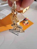 High Qualtiy Marque Designer Keychain Fashion Purse Pendentif Car Chain Charme Sac Charme Cadeau Cadeaux Cadeaux Cadeaux