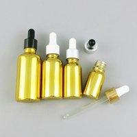 Botellas de almacenamiento Frascos 200 x 30 ml Botella de aceite esencial de vidrio de oro con gotero de aluminio 1oz 5ml 10ml 20ml 50ml 100ml contenedor