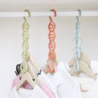Plastique ménage cintre de rangement porte-armoire armoire multifonctionnel 4 trous cintre crochet simple Sauvegarder space 3 couleurs DWF5182