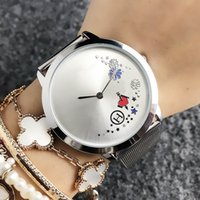 Montre-bracelet de la marque de mode pour femmes hommes style fleur de style métal bande métal montre de quartz Tom27