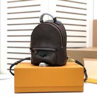 Mini sac à dos en toile revêtue classique avec garniture en cuir pince à glissière doré STRAPS STRÊTE DE STRÊTE DE SUPPORT POUR ÉPAUTEUR OU BANDESSE