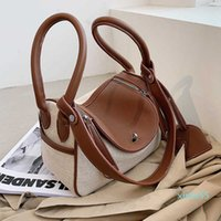 Handbags s High sense small women's fashion one shoulder hand contrast ins foreign style lady messenger