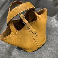 نقية اليدوية الشمع الموضوع 2021 لون جديد مطابقة الخضروات سلة حقيبة جلدية دلو ح حقيبة litchi نمط حقيبة المحمولة