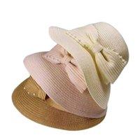 Amplia sombreros de ala 2021 Verano Mujeres Sombrero Paja Pescador Damas Sun Plegable Elegante Pearl Bowknot Femenino Anti-UV Playa