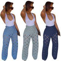 Fondos de maternidad 2021 Pantalones de mezclilla de verano Mujeres Retro Agujero Sólido Jeans Rippado Pierna ancha Pantalones Calle Hollow Out High Cintura Lady Pants1
