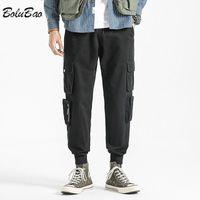 Calças masculinas bolbua homens casuais streetwear cor sólida multi-bolsos japoneses ferramentas estilo calças de alta qualidade homem solto