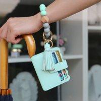 حقيبة جلدية حقيبة الشرابة سحر أساور سيليكون حبة معصمه صفعة المحفظة المفاتيح للنساء الأطفال الأزياء والمجوهرات