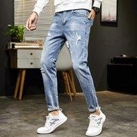 Nova Primavera verão outono homens jeans meados cintura cadeia calças de corpo inteiro calças denim para macho