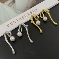 Stud South Korean Niche Designer Simple Cold Wind Metal Brass Gold-plated Asymmetric Pearl Earrings