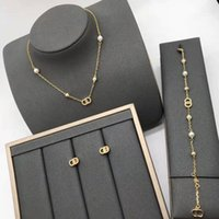 in 2021, d Family Pearl Clavicle Chain Necklace Fashion Brass Bracelet 925 Silver Needle Earrings for Women