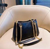 Vente en gros de luxe de luxe en cuir véritable dames noire classique sac à bandoulière à deux mains en relief