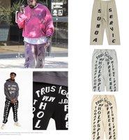Di alta qualità Kanye West Uomo Sloase Letter Stampa Pantaloni Jeans Uomini Europeo e Americano Fashion Grande Dimensioni Capris Casual Casual Bello Abbigliamento Coppia Pantalone in pile