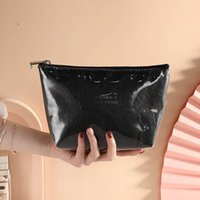 50pcs Cosmetic Bags Women TPU Dupont paper Brief Solid Large Capacity Storage Bag Mix Color