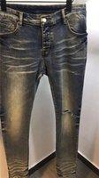 Designee Fashion Mens 슬림 - 다리 청바지 고품질 블랙 스키니 맞는 찢어진 찢어진 된 청바지 높은 거리 파괴 된 바이커 데님 청바지 29-38