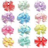 Vêtements pour chiens 50/100 PCS Cravates d'arc de compagnie pour petits accessoires de toilettage moyennes Bowknot Fournitures